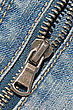 Closeup Of The Zipper Of A Stylish Blue Jeans stock photography