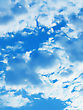 Clouds On Blue Sky Vertical Background stock photography