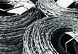 Metallic Coils of Barb Wire stock photo