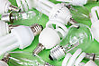 Collection Of Different Kind Of Lightbulbs On Green Background stock photo