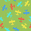 Colored Airplane Silhouette Seamless Pattern On Green Background