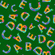 Colorful Alphabet Seamless Pattern. Set Of Colored Letters On Green