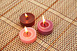 Colorful Candles On Bamboo Background. stock photo