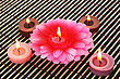 Colorful Candles On Bamboo Background. stock photography