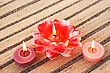 Colorful Candles On Striped Mat. stock image