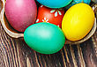 Tradition Colorful Easter Eggs In Brown Basket stock image
