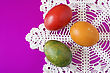 Colorful Easter Eggs On Decorative Napkin stock photo