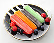Colorful Ice Cream Pops With Berries On A Plate stock image