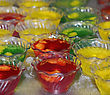 Desserts Colorful Jello Desserts In Plastic Bowls stock photo