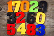 Colorful Plastic Numbers On The Wooden Background stock image