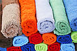 Colorful rolled towels as a background. stock image