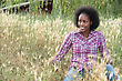 Coloured Girl In High Grass stock photo