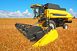 Combine Harvester On A Wheat Field With A Blue Sky stock photography