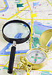 Compass And Magnifying Glass On The Map stock photography