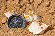 Navigation Compass And Seashells In The Beach Sand stock photo