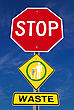 Conceptual Stop Sign With Dollar Waste Word And Symbol Warning Over Blue Sky stock photo