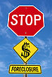Conceptual Stop Sign With Word Foreclosure And Shattered Dollar Symbol Over Blue Sky stock image