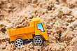 Hydraulic Construction Concept. Orange Dump Truck Fully Loaded Sand stock photography
