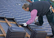 Construction Worker Laying Roof Tiles stock photo