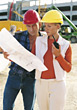 Construction Workers Looking At Plans stock photo
