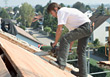 Construction Working Cutting Roof stock image