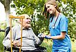 Ill Contented Senior Patient With Kind Doctor At The Nursing Home stock photo