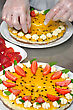 Cook Garnishing A Passionfruit Cheesecake With Strawberries And Mint stock image