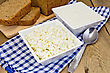 Cottage Cheese And Sour Cream In White Square Bowls On A Checkered Blue Napkin With Spoon, Rye Bread On A Wooden Boards Background stock photo