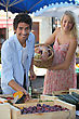 Couple At A Market Stall stock photography
