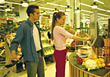 Shopping Couple At Grocery Self-Checkout stock photo