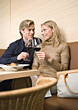 Couple At Restaurant Drinking Red Wine stock image