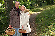 Find Couple With Basket Of Chestnuts And Mushrooms stock photo