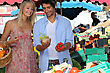 Couple Buying Vegetables stock image
