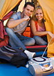 Couple Camping In Tent With Radio stock photo