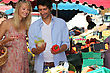 Couple Choosing Vegetables At The Market stock photo