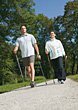 Couple Doing Nordic Walking Exercise stock photo