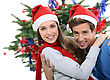 Couple Dressed In Festive Hats stock photo