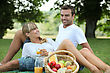 Blond Couple Enjoying Picnic stock photo