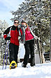 Skiing Couple Enjoying Skiing Trip stock photo