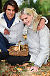 Couple Gathering Mushrooms In Basket stock photography