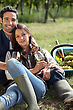 Couple With A Glass Of Wine And Basket Of Grapes stock photography