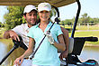 Golf Couple In Golf Car stock photo