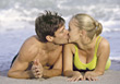 Couple Kissing on the Beach stock photography