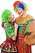 Smiling Couple Of Colorful Clowns. stock photo
