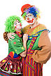 Playful Couple Of Funny Clowns. stock photography