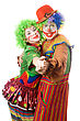 Couple Of Happy Clowns Dancing. stock photo