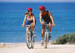 Couple On Bicycles By The Ocean stock photo