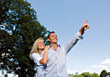 Couple Outdoors Pointing at Something stock photography