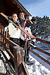 Couple Outside A Ski Lodge stock photography