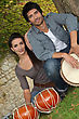 Couple Playing The Drums Outside stock photo